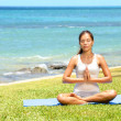 Yoga woman meditating woman relaxing by sea — Stockfoto
