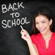 Back to school - woman teacher smiling blackboard — Stok fotoğraf