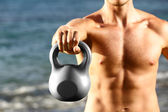Crossfit fitness man training with kettlebell — Stock Photo