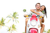 Free young couple on scooter on summer vacation — Stock Photo