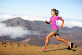 Female running athlete - woman trail runner — Stock Photo