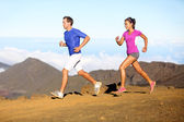 Running sport - Runners couple in trail run — Stock Photo