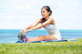 Woman training fitness stretching legs exercise — Stock Photo
