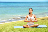 Yoga woman meditating woman relaxing by sea — Stock Photo