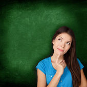 Thinking woman student or teacher with blackboard — Stock Photo