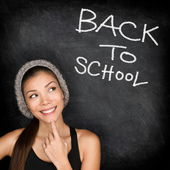 Back to school chalkboard - woman student thinking — Stock Photo