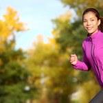 Female runner running in fall forest outside — Stock Photo