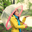 Umbrella woman in Autumn excited under rain — Stockfoto