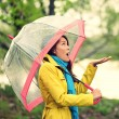 Umbrella woman in Autumn excited under rain — 图库照片