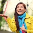 Stock Photo: Autumn woman happy after rain walking umbrella