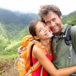 Hiking couple - young couple in love on Hawaii — Stock Photo #28788553