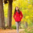 Fall girl walking on Autumn forest path happy — Stock Photo #28788557