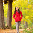 Fall girl walking on Autumn forest path happy — Stock Photo