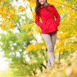 Beautiful young woman fall autumn nature scene — Stock Photo