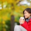 Autumn, fall woman drinking coffee looking — Stock Photo