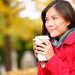 People drinking coffee - autumn woman in fall — Stock Photo #28788617