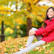 Fall woman relaxing happy in autumn forest foliage — Stok fotoğraf