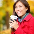 Coffee drinking woman in Autumn fall enjoying fall — Stok fotoğraf