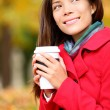 Coffee woman enjoying fall and coffee in autumn — Stock Photo