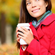 Coffee woman enjoying fall and coffee in autumn — Stok fotoğraf