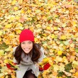 Stock Photo: Autumn , Fall leaves background with woman happy
