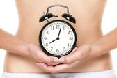 Biological clock ticking - woman holding watch — Stock Photo