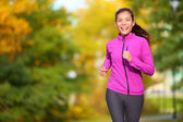 Female jogger - young woman jogging in the park — Stock Photo