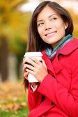 Coffee woman enjoying fall and coffee in autumn — Stock Photo