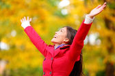 Autumn, fall woman happy in free freedom pose — Stock Photo