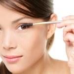 Mascara woman putting makeup on eye closeup — Stock Photo