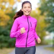 Running sport woman training in fall autumn forest — Stock Photo