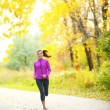 Autumn lifestyle woman running in fall forest — Stock Photo