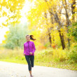 Autumn lifestyle woman running in fall forest — Stock Photo #29023973