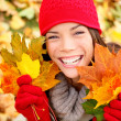 Autumn woman holding fall leaves in forest — Stock Photo