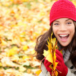 Asian Autumn woman holding fall leaves in forest — Stock Photo