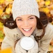 Autumn woman drinking coffee in fall forest — Stock Photo