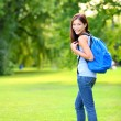 Student girl portrait wearing backpack outdoor — Stock Photo #29024197