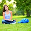 Student girl studying in park going back to school — Stok fotoğraf