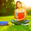 Student studying in park going back to school — Stock Photo