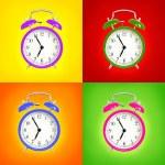 Alarm clocks isolated on colorful background — Stock Photo #29024289