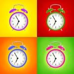 Alarm clocks isolated on colorful background — Stock Photo