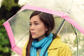 Melancholia - Melancholic woman in rain — Stock Photo