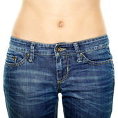Woman waist wearing jeans. Weight loss stomach. — Stock Photo