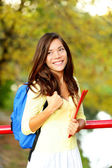Young woman adult student in autumn back to school — Stock Photo