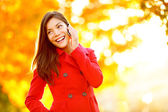 Smart phone Autumn woman talking on mobile in fall — Stock Photo