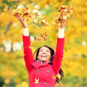 Autumn, fall woman happy throwing leaves — Stock Photo