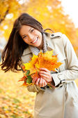 Fall, Autumn woman holding colorful leaves — Stock Photo