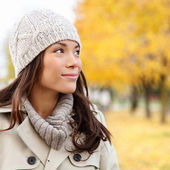 Thinking autumn woman looking at fall forest — Stock Photo