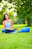 Student girl studying in park going back to school — Stock Photo