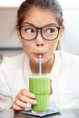 Green vegetable smoothie juice - woman drinking — Stock Photo